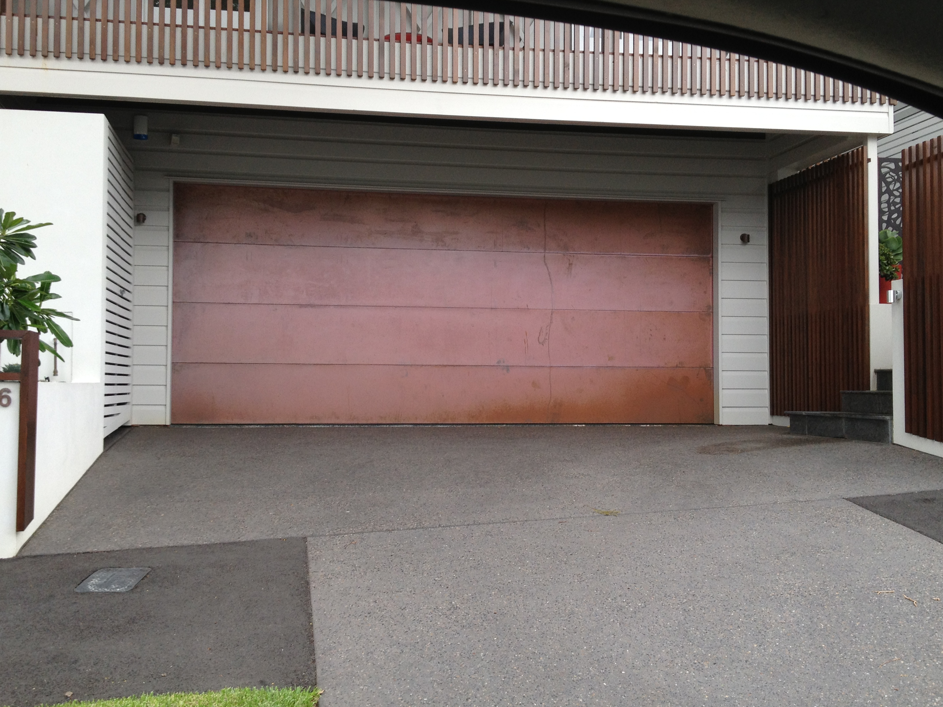 Garage door material how to choose garage door for Garage door materials